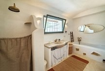 Lamia bathroom with shower and bathtub